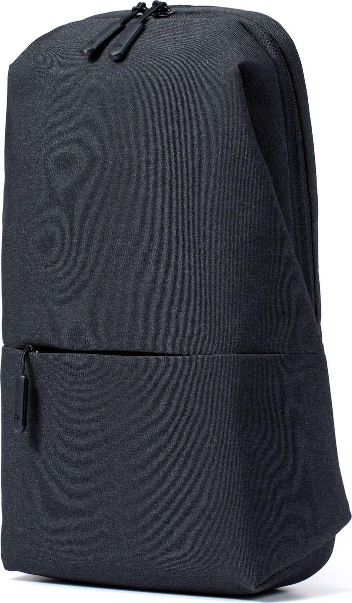Xiaomi Mi City Sling Bag, Dark Grey рюкзак для планшетаZJB4070GLУльтракомпактный и в то же время вместительный рюкзак Mi City Sling Backpack станет оптимальным выбором для тех, кто молод и полон сил, индивидуален и уникален, устал от стереотипов и хочет выделиться из основной массы. Эта модель отлично подойдет для городских условий, ведь внутри него легко поместятся все принадлежности, так необходимые Вам в течение дня. Многоуровневая система хранения гарантирует порядок внутри рюкзака (основное отделение с вертикальной загрузкой и специальным фиксатором, две дополнительные секции и секция на молнии). Вместительный втачной карман со скрытой молнией на лицевой стороне рюкзака обеспечит удобный и быстрый доступ к наиболее часто используемым принадлежностям. Широкая, регулируемая нейлоновая лямка мягко и равномерно распределяет вес – Mi City Sling Backpack удобно носить через плечо. Вам также нет необходимости снимать рюкзак каждый раз, когда необходимо что-либо из него достать. Сетчатая поверхность «спинки» из плотной ткани обеспечивает отличную вентиляцию, позволяет вашей спине свободно «дышать». Mi City Sling Backpack изготовлен из прочного и долговечного полиэстера, устойчивого к потертостям, благодаря чему надолго сохраняет первоначальную форму и вид. Водоотталкивающее покрытие (как с внешней, так и с внутренней сторон рюкзака) в дождливый период защитит содержимое рюкзака от промокания. Надежная и износостойкая фурнитура, удобные язычки молний с пластиковыми заглушками – Mi City Sling Backpack продуманный до мелочей.