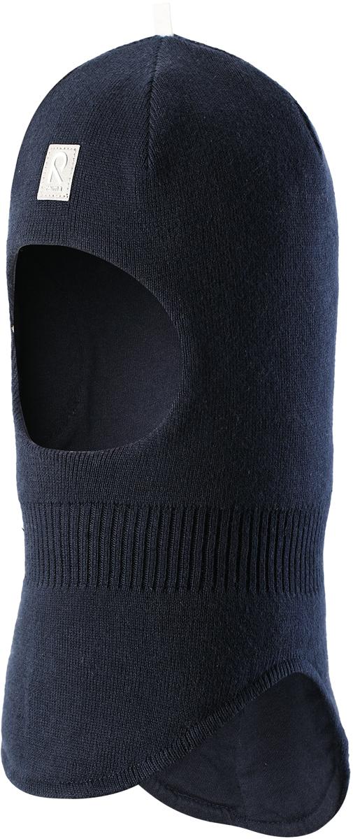 Шапка-шлем детская Reima Honka, цвет: темно-синий. 5184526980. Размер 465184526980Классическая детская шапка-шлем от Reima– незаменимый аксессуар, ведь она согревает не только голову, но и шею. Эта шапка-шлем сшита из эластичного и дышащего хлопкового трикотажа на подкладке из гладкого хлопкового джерси. Новые свежие весенние расцветки! Изделие сертифицировано по стандарту Oeko-Tex.