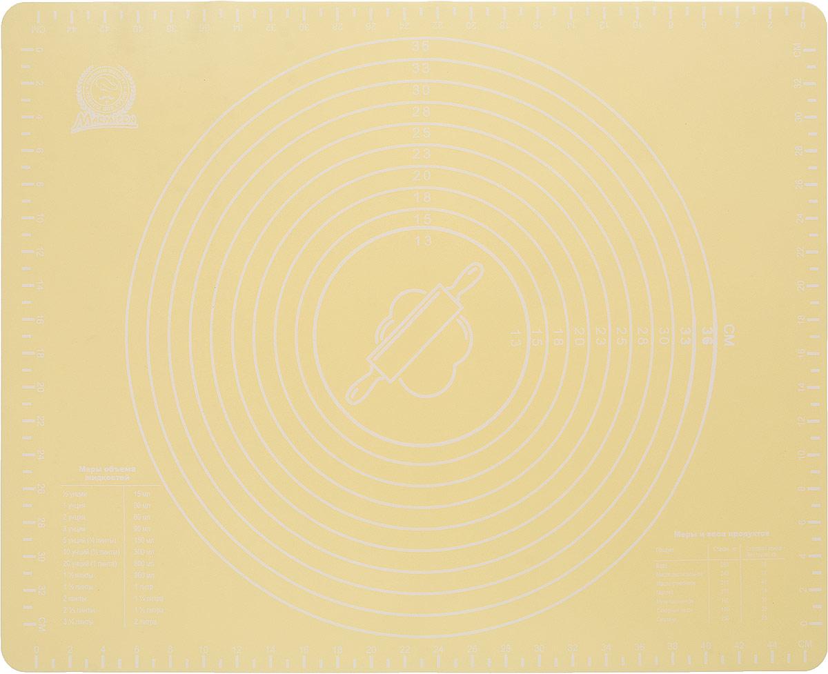 Коврик кулинарный Marmiton, со шкалой, цвет: желтый, 50 х 40 см16179Кулинарный коврик марки Marmiton предназначен для приготовления и резки теста, замораживания полуфабрикатов. Материал устойчив к фруктовым кислотам, к воздействию низких и высоких температур. Шкала, нанесенная на коврик, поможет раскатать тесто необходимого размера. Коврик обладает естественным антипригарным свойством, легко скатывается и хранится, не занимая много места, его можно мыть и сушить в посудомоечной машине. Удобный и практичный коврик придется по душе любому кулинару.