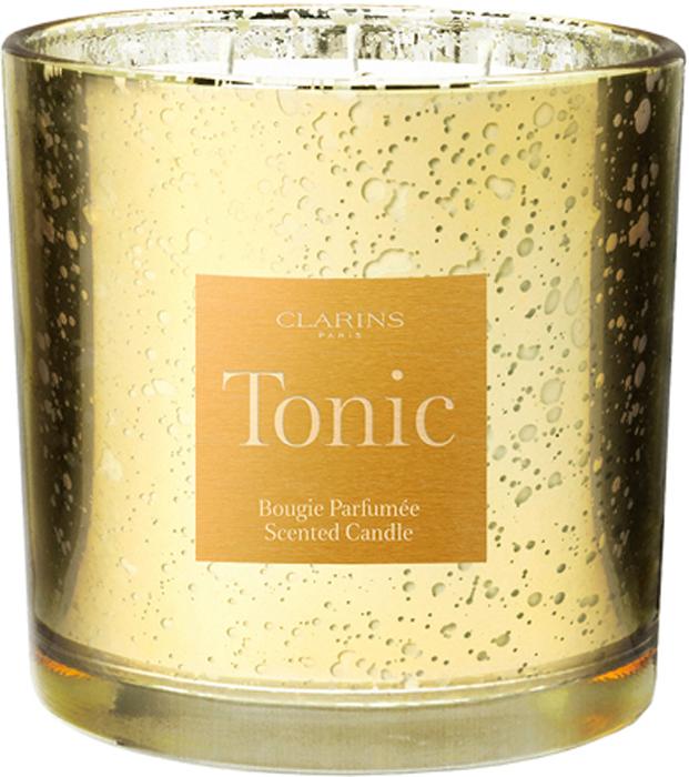 """Элегантная свеча """"Clarins"""" не только станет прекрасным элементом декора, но и наполнит дом тонизирующим ароматом легендарного масла Tonic. Чистые эфирные масла герани, апельсина и мяты подарят хорошее самочувствие и ощущение внутренней гармонии. Приблизительное время горения свечи – 50 часов."""