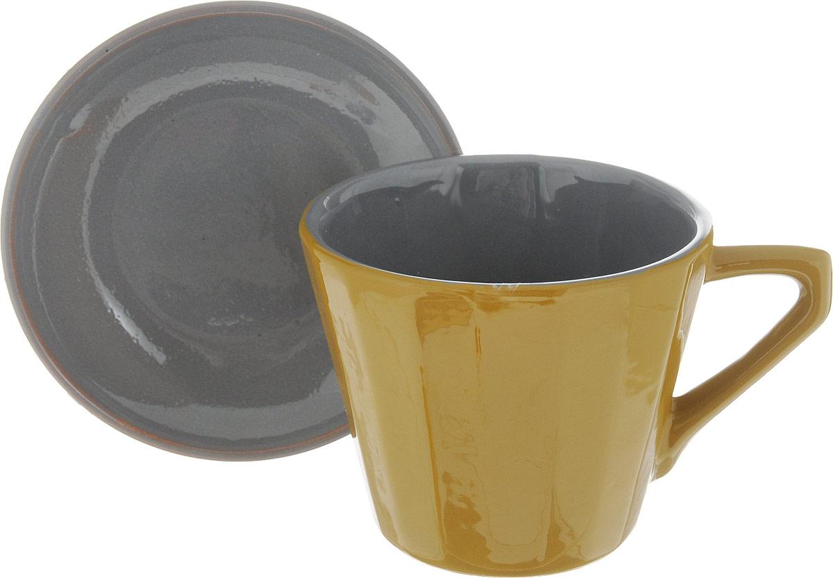 Чайная пара Борисовская керамика Ностальгия, цвет: серый, 200 млРАД14458002_серыйЧайная пара Борисовская керамика Ностальгия состоит из чашки и блюдца,изготовленных из высококачественной керамики. Такой набор украсит вашкухонный стол,а также станет замечательным подарком к любому празднику.Можно использовать в микроволновой печи и духовке. Диаметр чашки (по верхнему краю): 8 см. Высота чашки: 6,5 см. Диаметр блюдца (по верхнему краю): 10 см. Высота блюдца: 2 см. Объем чашки: 200 мл.