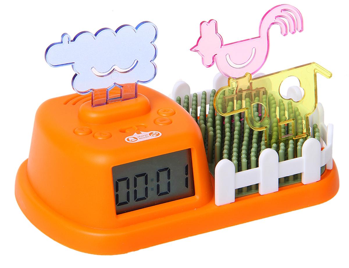 """Часы-будильник Веселая ферма. 138394138394В комплекте с будильником """"Веселая ферма"""" идут три фигурки животных - петух, овца, корова. Сам будильник имеет три мелодии (крик петуха, блеяние овечки и мычание коровы). В зависимости от того, звуки какого животного начнут воспроизводиться, вам нужно взять правильную фигурку животного и вставить в отсеки на крышке будильника - только тогда звук прекратится."""