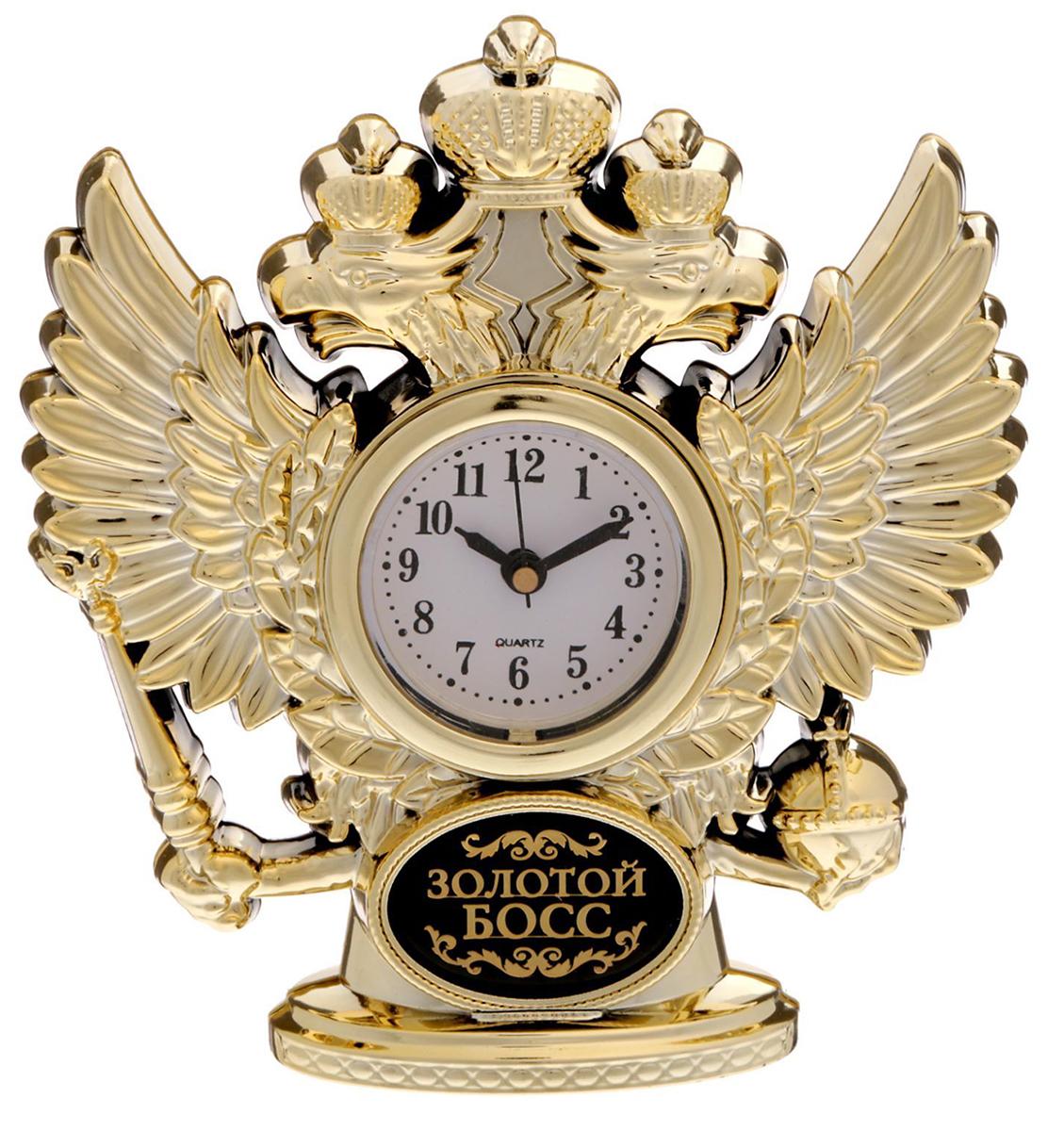 Часы настольные Золотой босс, 11 х 12 см. 16929141692914Изделие созданоы для истинных патриотов с твёрдым характером. Двуглавый орёл, словно стоит на страже вашего времени, обрамляя циферблат и придавая предмету статусный облик. Изделие прекрасно дополнит письменный стол или стеллаж в кабинете, ведь это не просто часы, но и стильная статуэтка. На обратной стороне вы найдёте мотивирующую на покорение всего мира надпись! Инструкция Аккуратно достаньте механизм с циферблатом из корпуса. Установите время с помощью колёсика. Вставьте механизм обратно. Часы работают от батареек AG 13. Сувенир преподносится в подарочной коробочке с прозрачным окном.