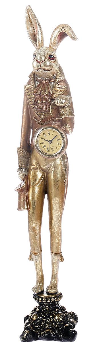 """Статуэтка """"Заяц с часами в золотом камзоле"""" прекрасно подойдет для украшения интерьера. Изделие выполнено из полистоуна. Статуэтка - это сувенир в полном смысле этого слова. И главная его задача - хранить воспоминание о месте, где вы побывали, или о том человеке, который подарил данный предмет. Преподнесите эту вещь своему другу, и она станет достойным украшением его дома."""