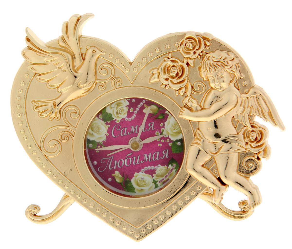 Часы Самая любимая, 11 х 9 см. 906874906874Часы Самая любимая - это олицетворение неповторимой грации в декоративном элементе интерьера. Они придутся по душе натурам романтичным и нежным, предпочитающим необычные детали в оформлении дома. Символы любви – голубь и Купидон – придают изделию неповторимый шарм. Часы выполнены из металла c ярким циферблатом, располагаясь на прочных ножках, и работают от батареек LR44 (не входят в комплект). Кроме того, они включают функцию будильника, что делает их не только красивыми, но и полезными. Теперь вы ни за что не проспите важное событие и будете встречать каждый новый день с улыбкой!