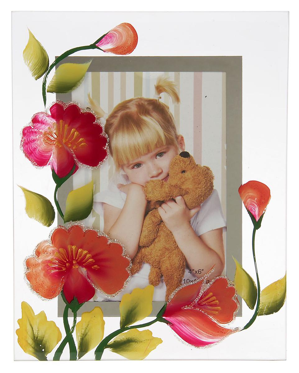Фоторамка Любимые цветы, 10 х 15 см. 10291351029135Фоторамка Любимые цветы сохранит самые прекрасные моменты вашей жизни.Характеристики: Материал: стеклоРазмер: 10 х 15 см.