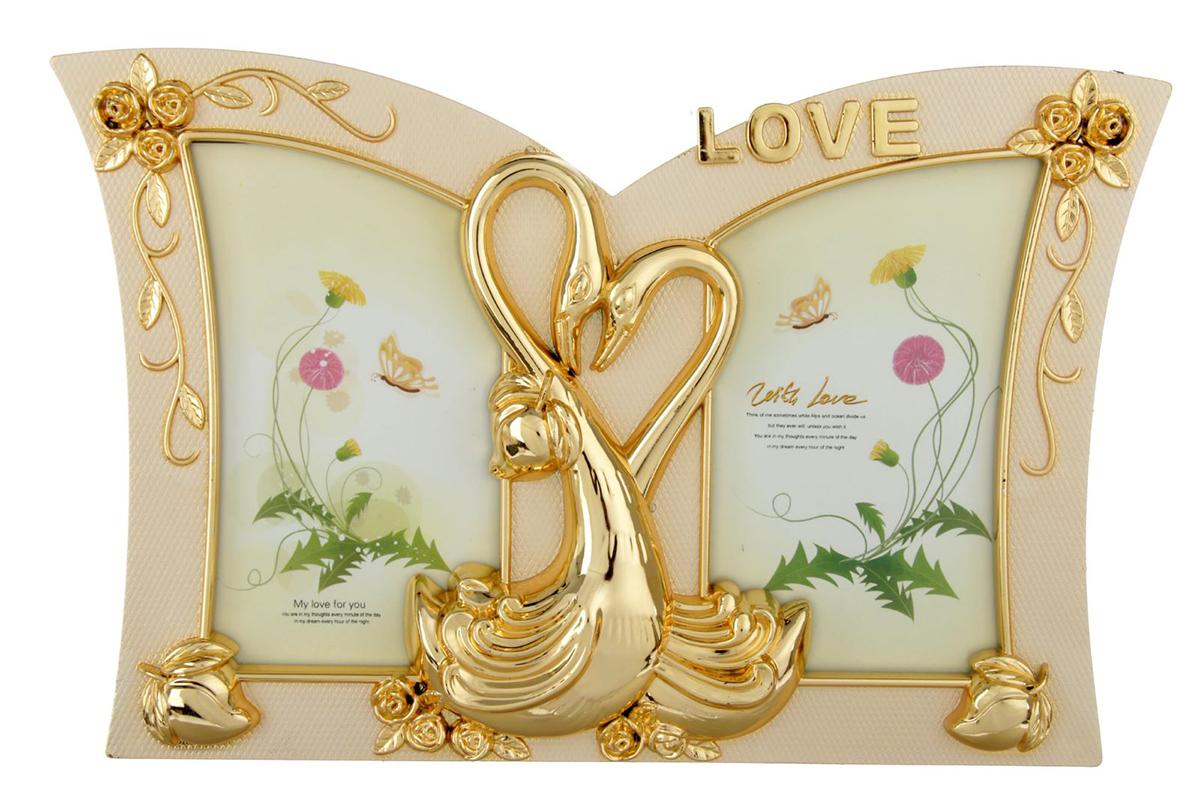 Фоторамка Лебеди - любовь и верность, на 2 фото, 6 х 11 см, цвет: золотой. 19335821933582Фоторамка - казалось бы, небольшой аксессуар, который напомнит о счастливых днях, проведенных наедине друг с другом, с семьей, а также украсит домашний интерьер, придавая ему тот неповторимый уют, который возможен только в доме, где царят гармония и любовь. Она станет замечательным подарком на 14 февраля, годовщину или в другой значимый для вас день, чтобы просто порадовать свою вторую половинку.