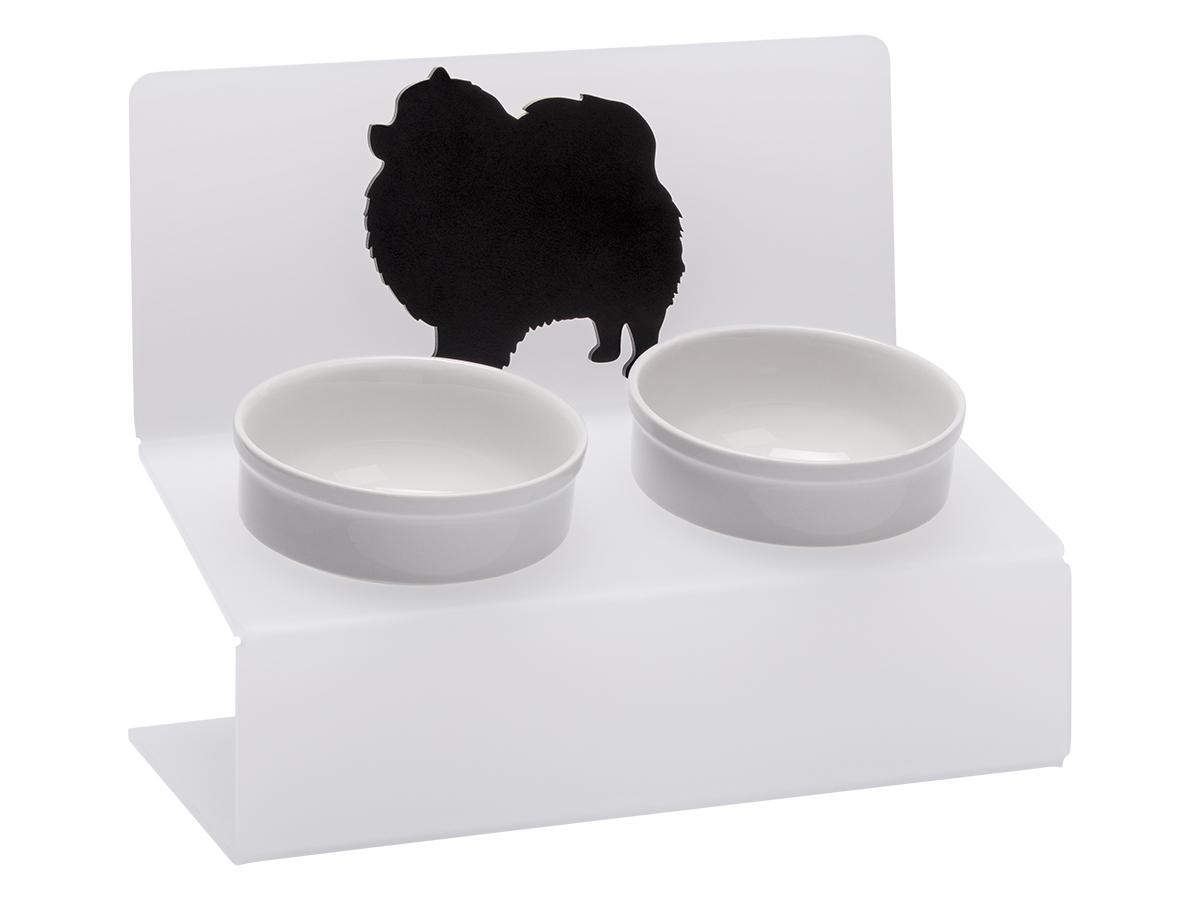 Миска для животных Artmiska Шпиц, двойная, на подставке, цвет: белый, полупрозрачный, 2 x 350 млШ-6АртМиска – фарфоровые миски на уникальной подставке с наклоном, созданные специально для собак мелких пород. Высота подставки и угол ее наклона максимально обеспечивают правильное положение тела питомца при кормлении. При этом возникает намного меньшее напряжение на шейно-грудной отдел, передние конечности и суставы. Миски, поднятые на подставках нужны как молодым, так и пожилым животным. Использование АртМиски минимизирует количество воздуха, которое попадает в желудок животного во время проглатывания корма, что в свою очередь приводит к лучшему пищеварению, помогает предотвратить срыгивание и рвоту. Оптимальная высота и угол наклона подставки, форма и объем миски эффективно снижают разбрасывание корма домашним питомцем. С АртМиской вы все реже будете видеть корм на полу после каждого кормления. Противоскользящие ножки обеспечивают неподвижность подставки на любой поверхности пола. АртМиска органически впишется в любой интерьер и будет долго радовать ваш глаз. Мы уверены - Artmiska станет лучшим подарком для вашего четвероногого друга! Подставка: материал - акриловый пластик - отличная стойкость к ударам, поверхность не задерживает загрязнений и легко чистится, не вызывает аллергии, не выцветает со временем; размер (ДхШхВ) - 30х15,5х25 см. Миска съемная: материал - фарфор; можно использовать в микроволновой печи и посудомоечной машине; диаметр - 12 см., объем 350 мл х 2шт. Белый полупрозрачный цвет подставки с эффектом матового стекла великолепно сочетается с чёрным, белым и др. цветами интерьера. Товар защищен потентом РФ.