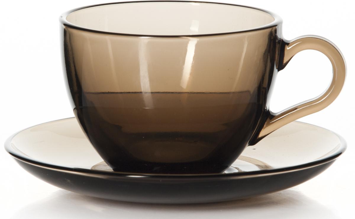 """Чайный набор Pasabahce """"Броунз"""" состоит из шести чашек ишести блюдец. Предметы набора изготовлены из прочногонатрий-кальций-силикатного стекла. Изящный чайный набор великолепно украсит стол к чаепитиюи порадует вас и ваших гостей ярким дизайном и качествомисполнения.Можно использовать в холодильнике и мыть впосудомоечной машине.Диаметр чашки по верхнему краю: 9,2 см.Высота чашки: 6,3 см.Объем чашки: 215 мл.Диаметр блюдца: 13,5 см."""