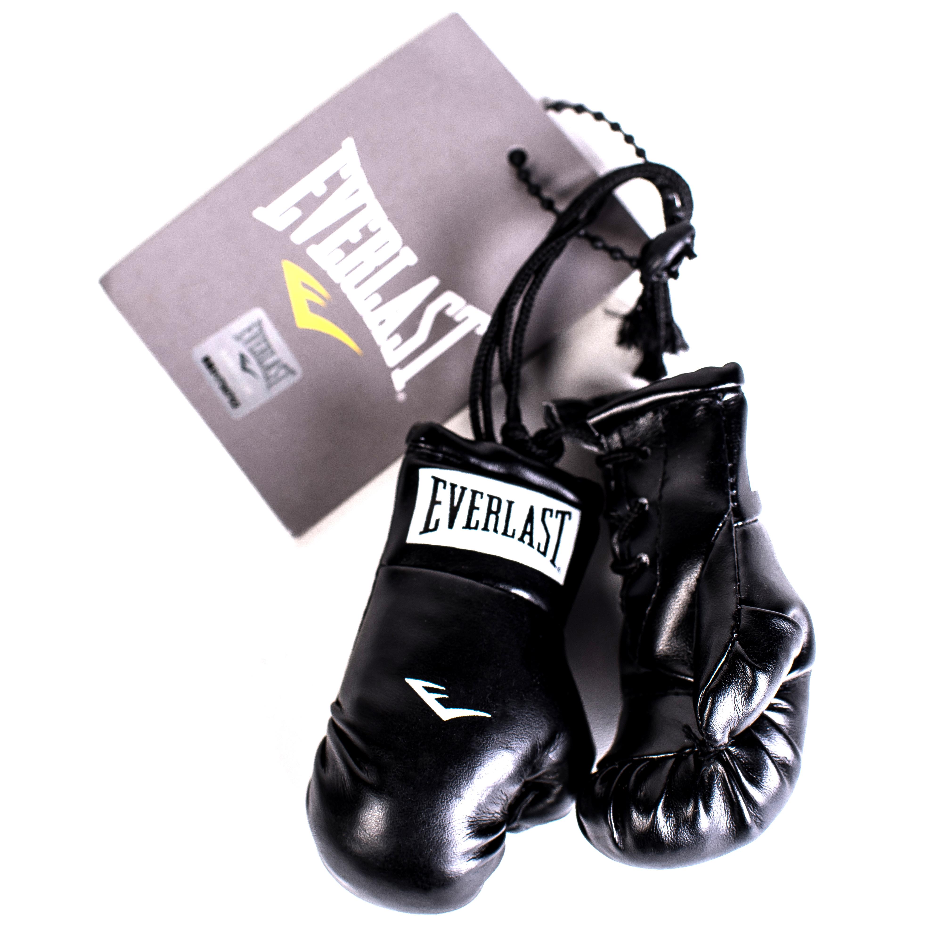 Брелок Everlast Mini Boxing Glove In Pairs, цвет: черный800001Брелок Everlast Mini Boxing Glove In Pairs в виде пары боксерских перчаток. Аутентичны оригиналу вплоть до шнуровки на манжетах. Превосходно подходят для автомобильного зеркала в салоне, спортивной сумки или просто для украшения вашей комнаты.