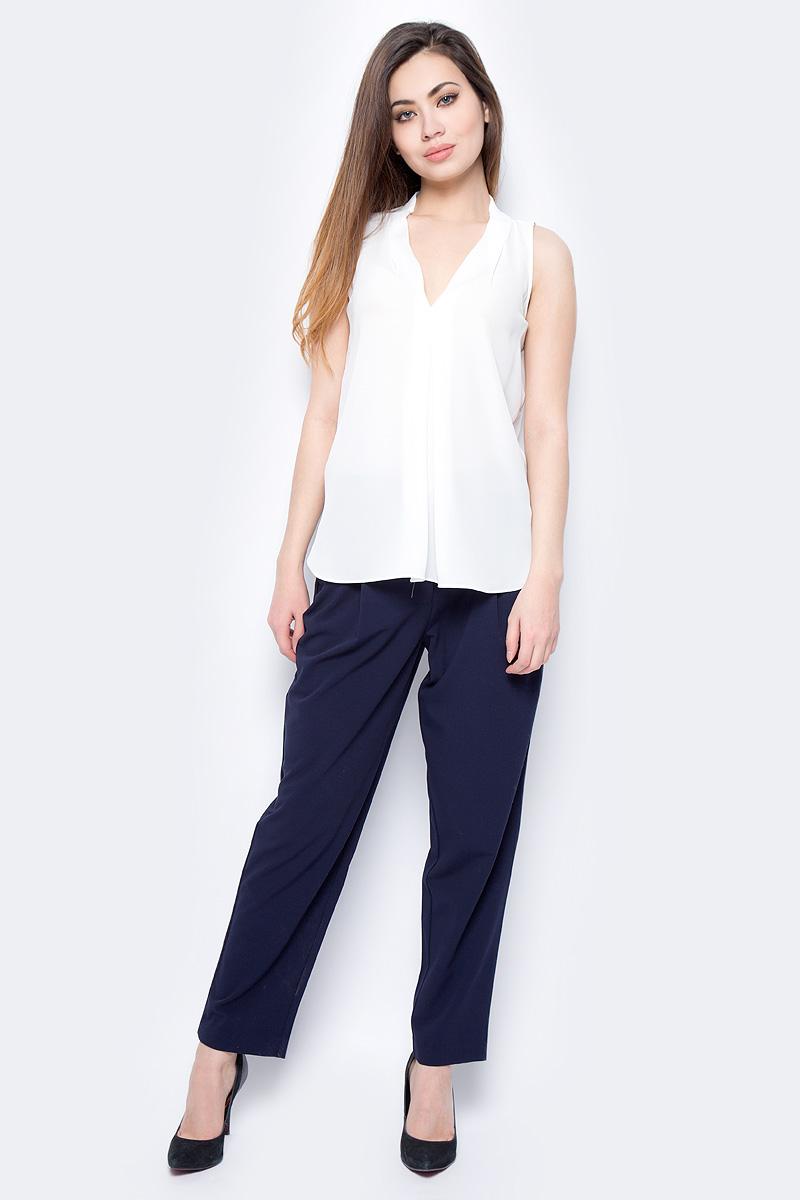 Блузка женская Sela, цвет: молочный. Twsl-112/805-8111. Размер 48Twsl-112/805-8111Стильная женская свободная блуза без рукавов с удлиненной спинкой, выполненная из 100% полиэстера, подчеркнет ваш уникальный стиль и поможет создать оригинальный женственный образ.