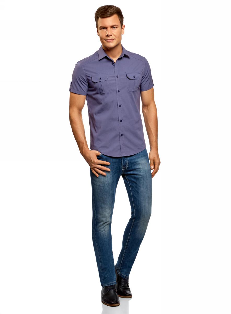 Рубашка мужская oodji Lab, цвет: синий. 3L410103M/46563N/7500N. Размер S (46/48-182)3L410103M/46563N/7500NПолуприталенная рубашка oodji с коротким рукавом и оригинальным принтом. Застежка на планке. Модель комфортно сидит благодаря вытачкам на спинке, и кокетке в форме погона. Короткие рукава с отворотами фиксируются хлястиками с пуговицей. Нагрудные карманы со скошенными уголками сшиты со встречной складкой и клапанами. Оригинальный контрастный принт в виде надписи на спинке придает рубашке особый колорит. Экологичная хлопковая ткань приятна в ношении и отлично пропускает воздух. Рубашка спортивного типа с коротким рукавом хорошо смотрится на любой фигуре. Для офиса ее можно сочетать с неклассическими брюками из вельвета или плотного хлопка. К такому комплекту подойдут лоферы или монки. Сумка-мессенджер завершит нестрогий официальный образ. На встречи с друзьями и прогулки по городу рубашку можно надеть навыпуск с джинсами и слипонами. Рубашка с коротким рукавом - легкий выбор на каждый день!