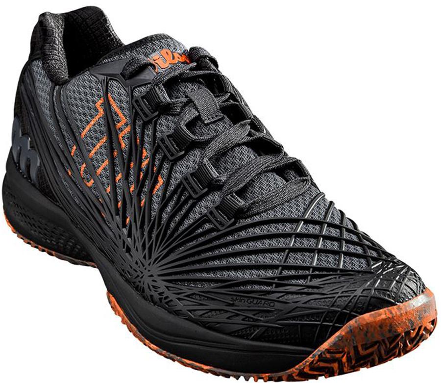 Кроссовки для тенниса мужские Wilson Kaos 2.0, цвет: черный, серый. WRS323840. Размер 9,5 (43)WRS323840Кроссовки Wilson Kaos 2.0 - модель 2018 года. Второе поколение супербыстрых и легких кроссовок для теннисистов, нуждающихся в комфортной обуви для агрессивной игры. Модель KAOS 2.0 - максимальный воздухообмен, обновлённая технология SKINGUARD и новое торсионное шасси PTC. Все эти характеристики обеспечивают высочайший уровень поддержки и быстрое ускорение. Классическая шнуровка гарантирует удобство и надежно фиксирует модель на ноге. Технология EndoFit создает идеальный обхват и посадку по ноге. Технология 2D-F.S для устойчивости и стабильности при боковых движениях; шасси Pro-Torque Chassis LT в верхней части подошвы контролирует поверхности при небольшом весе обуви. Технология Dynamic Fit-Dfz дает отличный контакт с кортом. Химически активные вещества R-DST в пяточной части для максимальной амортизации. Технология Duralast для лучшего сцепления с поверхностью корта. Съемная стелька EVA с внешней текстильной поверхностью обеспечивает комфорт во время пребывания на улице. Антибактериальная пропитка против запаха.