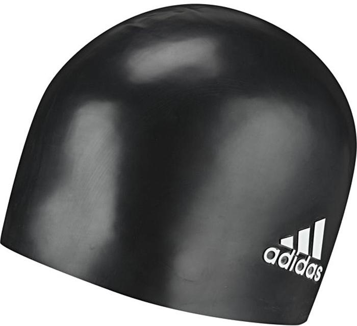 Шапочка для плавания Adidas Sil CP Logo 1PC, цвет: черный802316Удобная шапочка для снижения сопротивления воды. Лаконичная силиконовая шапочка для профессиональных пловцов плотно облегает голову, сохраняя волосы сухими в течение всей тренировки. Прочная и устойчивая к разрыву. Комфортная и надежная посадка. Рельефный логотип adidas у нижнего края. 100% силикон.