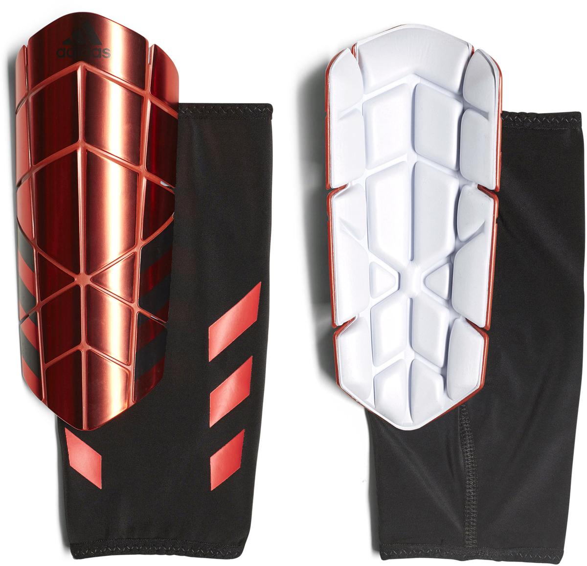 Щитки футбольные Adidas Ghost Pro, цвет: красный. Размер XSCF2431Щитки Adidas Ghost Pro для искусного маневрирования. Уверенно обходи защиту в этих футбольных щитках. Гибкие пластины повторяют изгибы голени и не сковывают движения во время маневрирования. Компрессионный рукав удерживает щитки на месте до конца матча.Гибкие рельефные пластины удобного размера обеспечивают максимальную защиту. Внутренний слой из ЭВА для оптимального комфорта и амортизации. Съемная передняя панель обеспечивает идеальную посадку и комфорт. Три полоски и логотип Adidas на лицевой стороне. Щитки выполнены из 95% полипропилена и 5% термопластичной резины.