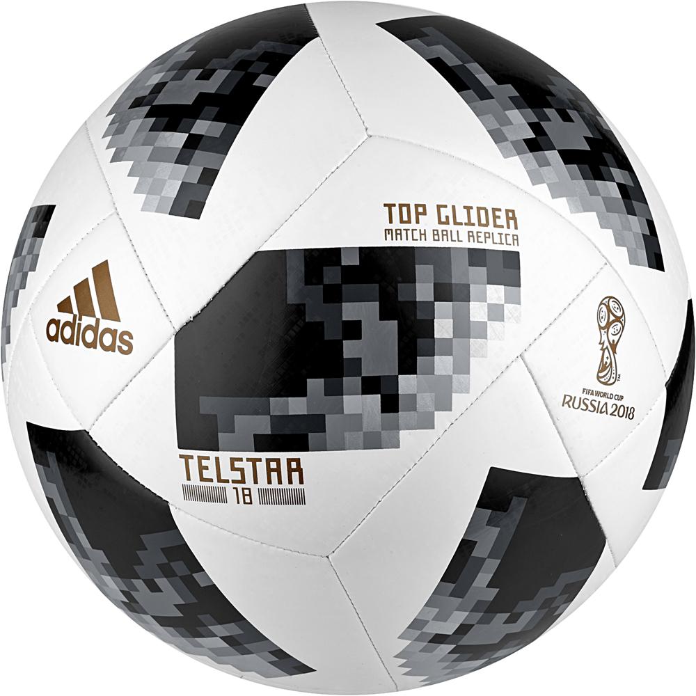 Мяч футбольный Adidas World Cup Tglid, цвет: белый, черный, серый. Размер 5CE8096Мяч, вдохновляющий на победы. Тренировочный мяч, выполненный в стилистике Чемпионата мира по футболу FIFA 2018 в России. Модель украшена пиксельной графикой, вдохновленной городскими пейзажами России и культовым мячом Telstar. Технология машинной сшивкии текстурные панели обеспечивают мягкий контакт и максимальную прочность. Мяч подходит для подвижных игр и тренировок. Бутилкаучуковая камера надежно удерживает воздух. Требуется накачать камеру, насос в комплект не входит. Лицензионная коллекция FIFA. Состав: 100% термополиуретан.