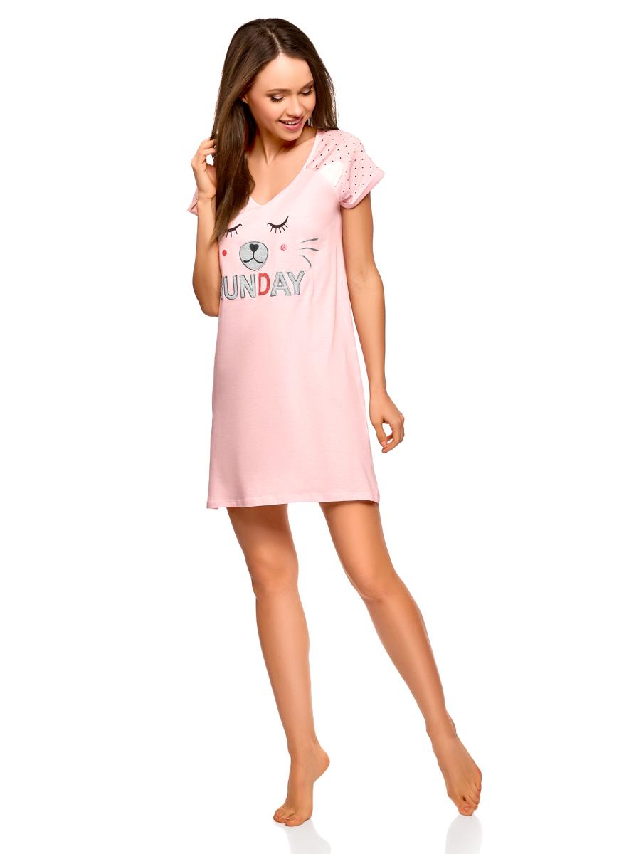 Платье домашнее oodji Ultra, цвет: светло-розовый. 59801018/47688/4020P. Размер XS (42)59801018/47688/4020PНеобычное трикотажное платье с аппликацией. Свободная модель с короткими рукавами и V-образным вырезом. Принтованные рукава реглан придают мягкость и закругленность линии плеч. На груди необычный принт с надписью, аппликация органично дополняет его и придает ему дополнительный объем. Трикотаж на основе хлопка приятен на ощупь и практичен в ношении: отлично держит форму после стирок, легко гладится и не теряет вида. Короткое платье свободного силуэта хорошо смотрится на любой фигуре. Стильное платье с аппликацией – прекрасная вещь для ношения дома. В нем удобно заниматься домашними делами или отдыхать в любимом кресле. Это платье можно использовать и как одежду для сна: оно легкое, не сковывает движений и позволяет даже в домашней обстановке выглядеть женственно и привлекательно. Отличное платье для создания комфортных и расслабленных домашних нарядов.