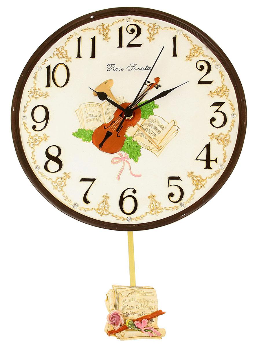 Часы настенные Маятник. Скрипка и ноты, диаметр 29 см1030844Каждому хозяину периодически приходит мысль обновить свою квартиру, сделать ремонт, перестановку или кардинально поменять внешний вид каждой комнаты. Часы настенные интерьерные Скрипка и ноты с маятником, d=29 см — привлекательная деталь, которая поможет воплотить вашу интерьерную идею, создать неповторимую атмосферу в вашем доме. Окружите себя приятными мелочами, пусть они радуют глаз и дарят гармонию.часы настенные серия маятник Скрипка и ноты d=29см 1030844