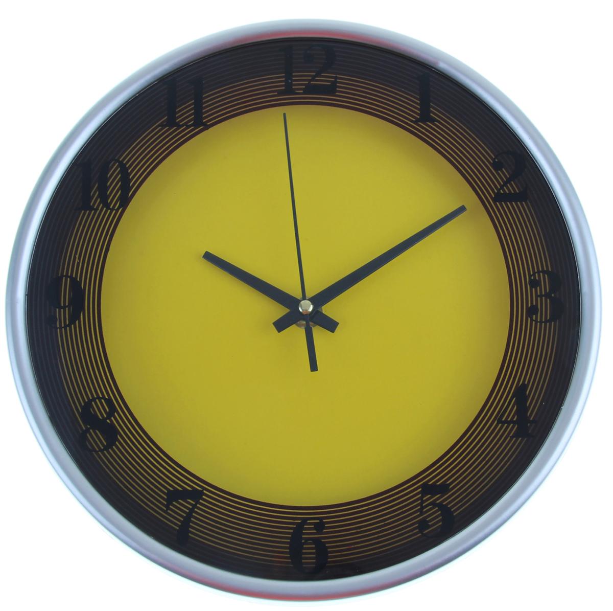 """Каждому хозяину периодически приходит мысль обновить свою квартиру, сделать ремонт, перестановку или кардинально поменять внешний вид каждой комнаты. Часы настенные круглые """"Два цвета"""", d=24,5 см, желто-коричневые — привлекательная деталь, которая поможет воплотить вашу интерьерную идею, создать неповторимую атмосферу в вашем доме. Окружите себя приятными мелочами, пусть они радуют глаз и дарят гармонию.Часы настенные круг, рама хром тонкая, циферблат желтый d=24,5см 1031016"""