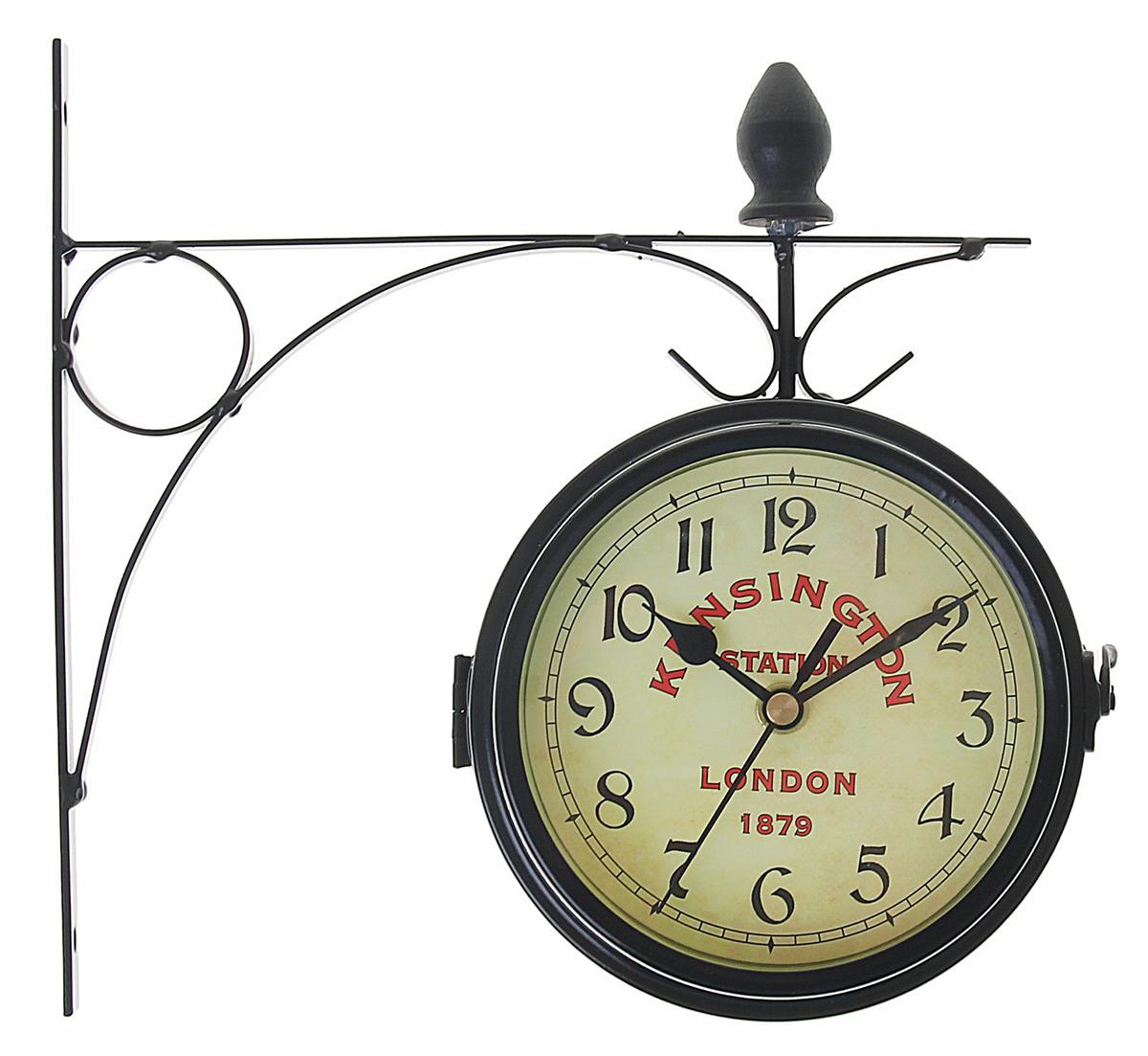 Часы настенные двойные Kinsington station, диаметр 16 см1252073Каждому хозяину периодически приходит мысль обновить свою квартиру, сделать ремонт, перестановку или кардинально поменять внешний вид каждой комнаты. Часы настенные двусторонние Kinsington station на подвесе, d=16 см, черные — привлекательная деталь, которая поможет воплотить вашу интерьерную идею, создать неповторимую атмосферу в вашем доме. Окружите себя приятными мелочами, пусть они радуют глаз и дарят гармонию.Двойные настенные часы, крепление-мет, Круг черный, на циферблате-Kinsington station d=16см 1252073