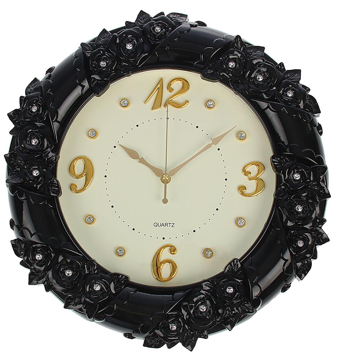 Часы настенные Лепнина, цвет: черный 48 х 48 см1392780Каждому хозяину периодически приходит мысль обновить свою квартиру, сделать ремонт, перестановку или кардинально поменять внешний вид каждой комнаты. Часы настенные круглые Пышные цветы, d=48 см, рама черная лепнина, циферблат белый — привлекательная деталь, которая поможет воплотить вашу интерьерную идею, создать неповторимую атмосферу в вашем доме. Окружите себя приятными мелочами, пусть они радуют глаз и дарят гармонию.Часы настенные, черная лепнина с декор камнями, бел циферблат, 48х48х6 см 1392780