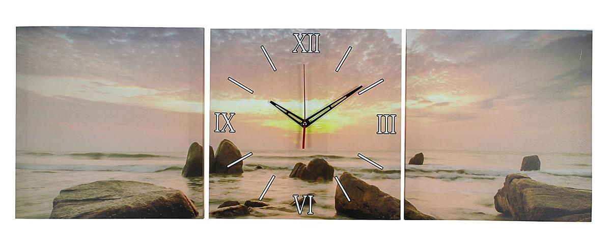 Часы настенные модульные Сюжет Закат на море, 35 х 110 см2045020Каждому хозяину периодически приходит мысль обновить свою квартиру, сделать ремонт, перестановку или кардинально поменять внешний вид каждой комнаты. Часы настенные модульные «Закат на море», 35 ? 110 см — привлекательная деталь, которая поможет воплотить вашу интерьерную идею, создать неповторимую атмосферу в вашем доме. Окружите себя приятными мелочами, пусть они радуют глаз и дарят гармонию. Часы настенные модульные «Закат на море», 35 ? 110 см — сувенир в полном смысле этого слова. И главная его задача — хранить воспоминание о месте, где вы побывали, или о том человеке, который подарил данный предмет. Преподнесите эту вещь своему другу, и она станет достойным украшением его дома.Часы настенные модульные Закат на море, 35х110 см микс 2045020
