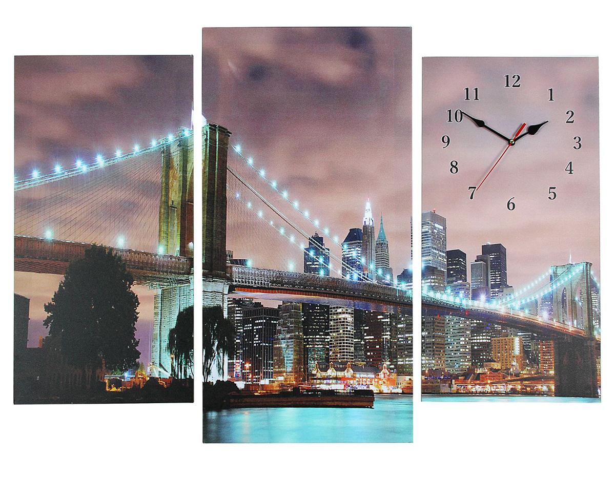Часы настенные модульные Сюжет Светящийся мост, 60 х 80 см2045044Часы настенные модульные «Огни Нью-Йорка», 60 ? 80 см — сувенир в полном смысле этого слова. И главная его задача — хранить воспоминание о месте, где вы побывали, или о том человеке, который подарил данный предмет. Преподнесите эту вещь своему другу, и она станет достойным украшением его дома. Каждому хозяину периодически приходит мысль обновить свою квартиру, сделать ремонт, перестановку или кардинально поменять внешний вид каждой комнаты. Часы настенные модульные «Огни Нью-Йорка», 60 ? 80 см — привлекательная деталь, которая поможет воплотить вашу интерьерную идею, создать неповторимую атмосферу в вашем доме. Окружите себя приятными мелочами, пусть они радуют глаз и дарят гармонию.Часы настенные модульные Светящийся мост, 60х80см микс 2045044
