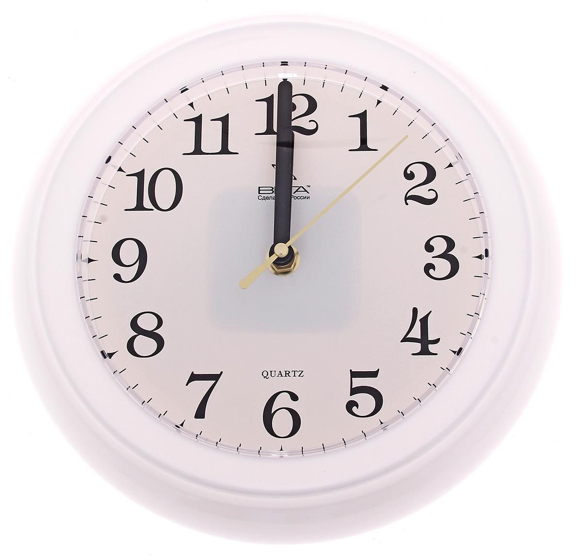 Часы настенные Вега, цвет: белый. 796780796780Каждому хозяину периодически приходит мысль обновить свою квартиру, сделать ремонт, перестановку или кардинально поменять внешний вид каждой комнаты. Часы настенные круглые Тайминг, d=22,5 см, белые — привлекательная деталь, которая поможет воплотить вашу интерьерную идею, создать неповторимую атмосферу в вашем доме. Окружите себя приятными мелочами, пусть они радуют глаз и дарят гармонию. Часы настенные круглые Тайминг, d=22,5 см, белые — сувенир в полном смысле этого слова. И главная его задача — хранить воспоминание о месте, где вы побывали, или о том человеке, который подарил данный предмет. Преподнесите эту вещь своему другу, и она станет достойным украшением его дома.Часы настенные классические круглые, белые 796780