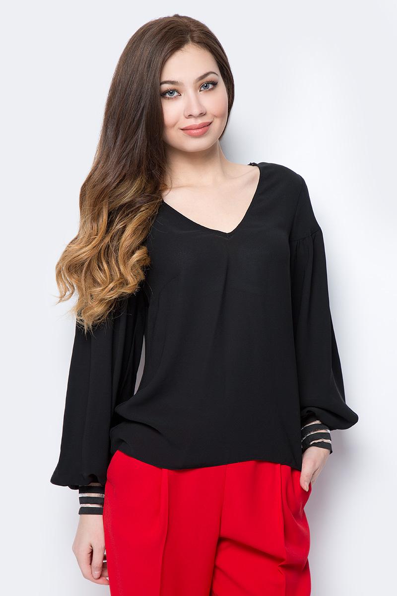 Блузка женская adL, цвет: черный. 11533747000_001. Размер M (44/46)11533747000_001Оригинальная женская блузка adL, изготовленная из легкого струящегося материала, поможет создать стильный повседневный образ. Модель свободного кроя с V-образным вырезом горловины и длинными широкими рукавами на манжетах. Модель подойдет для офиса, прогулок и дружеских встреч и будет отлично сочетаться с джинсами и брюками, а также гармонично смотреться с юбками. Мягкая ткань на основе полиэстера приятна на ощупь и комфортна в носке.