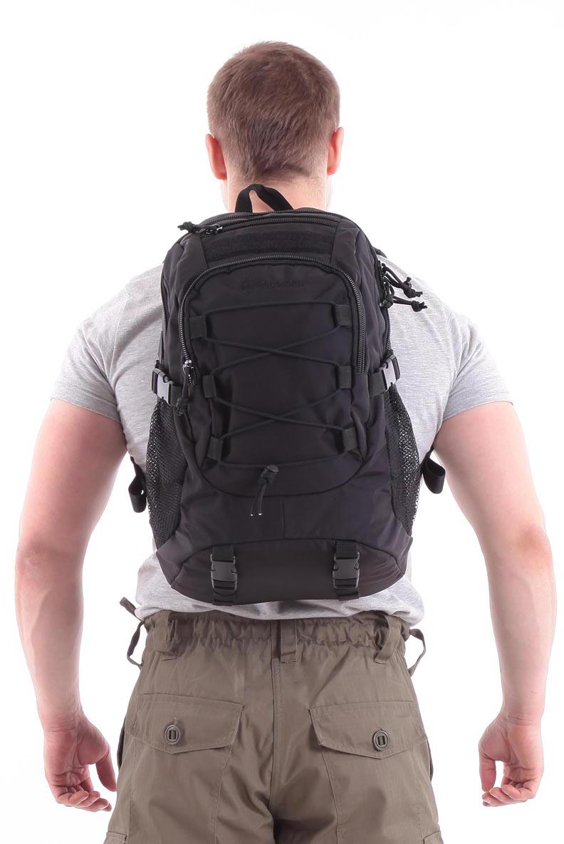 Рюкзак туристический KE Tactical Mission, цвет: черный, 25 л. 1002010610020106Для рюкзаков серии Mission характерна универсальность. Они подходят для военного и гражданского применения, для полевых условий и города. Компактный однодневный рюкзак KE Tactical 1-Day Mission подходит для переноски ноутбука с экраном в 15 дюймов. Для размещения лэптопа рекомендуется использовать плоский отсек в спинке рюкзака. В других обстоятельствах в этот плоский отсек закладывается мягкая вставка из изолона с каркасной пластиной или бронепластина подходящего размера.