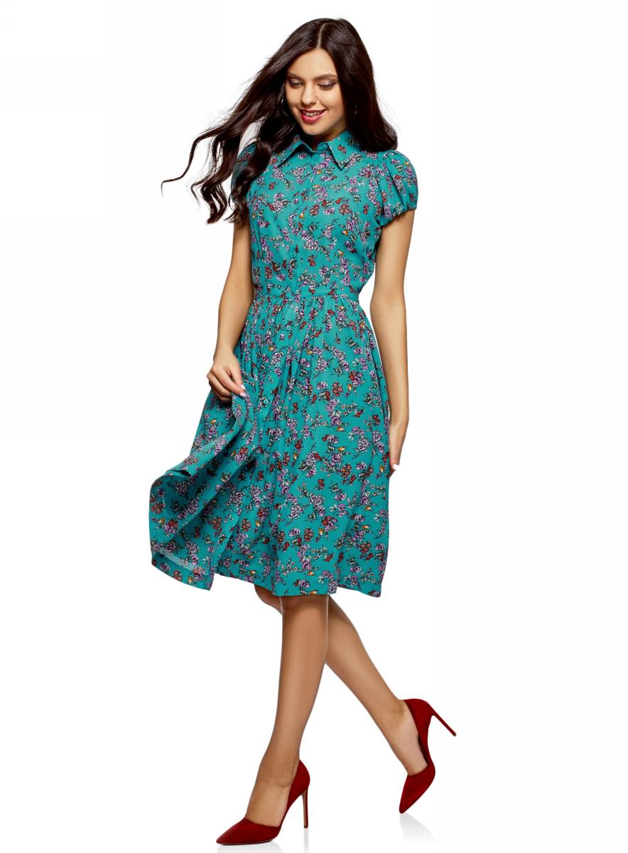 Платье oodji Ultra, цвет: бирюзовый, фуксия. 11913026/36215/7347F. Размер 36-164 (42-164)11913026/36215/7347FСтильное платье oodji Ultra, выгодно подчеркивающее достоинства фигуры, выполнено из качественного материала. Модель средней длины с рукавами-фонариками и отложным воротничком спереди застегивается на пуговицы по всей длине. Пышная расклешенная юбка дополнена по бокам удобными прорезными карманами.