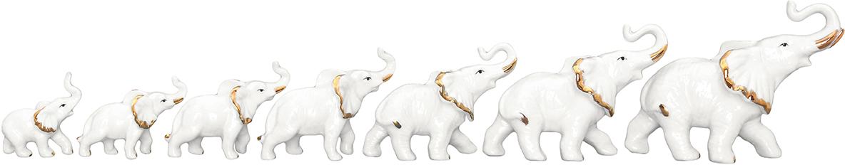 Фигурка декоративная Elan Gallery Семь слонов - Хранители дома, 7 предметов330607Изящная фарфоровая статуэтка в классическом стиле украсит ваш дом, а также станет идеальным подарком. Уют складывается из мелочей! Декоративная фигурка - это отличный способ поздравить близкого человека, поднять настроение себе и окружающим.