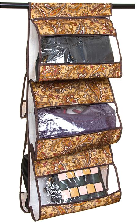 Кофр для хранения сумок El Casa Перо павлина, подвесной, 5 секций, цвет: коричневый, 40 х 10 х 90 см370625Кофр подвесной для сумок с 5 прозрачными секциями изготовлен из высококачественного материала. В шкафу всегда будет порядок, так как кофр для сумок не только очень компактен, но и, несмотря на свои размеры, вмещает множество вещей. Пять секций, расположенных с двух сторон, позволят вам удобно разместить свои сумочки, полотенца, зонтики и многое другое в легкодоступном месте. Размер 40х90 см.