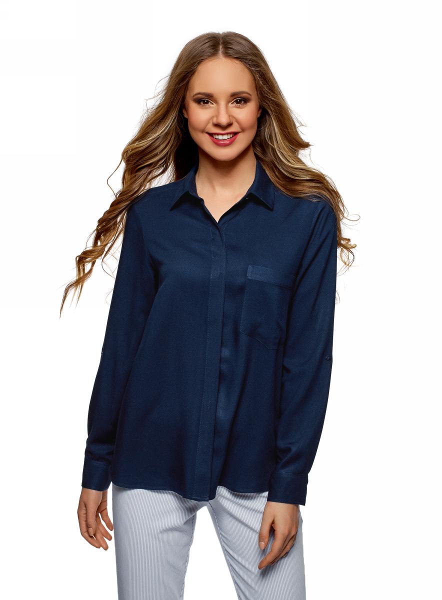 Блузка женская oodji Ultra, цвет: темно-синий. 13L11012-1/47741/7900N. Размер 36 (42-170)13L11012-1/47741/7900NЭлегантная блузка прямого силуэта с длинными рукавами и аккуратным отложным воротником. Скрытая застежка на пуговицы, на груди карман внушительных размеров. С ним модель смотрится более завершенной и интересной. Легкая вискозная ткань приятна для тела, позволяет коже дышать и красиво струится во время ношения. Такая блузка подойдет для разной погоды. Модель прямого кроя хорошо смотрится на любой фигуре. Стильная блузка с нагрудным карманом незаменима для делового и повседневного гардероба. В ней можно пойти в офис, на деловую встречу или в кино. Она прекрасно сочетается с разным низом. C джинсами получится непринужденный и сдержанный образ. Более элегантный и строгий наряд легко создать, надев ее с классическими брюками или юбкой прямого силуэта. Комплект можно дополнить жакетом, жилетом или кардиганом фактурной вязки. Прекрасная блузка украсит ваш гардероб и станет отличной основой для стильных и очаровательных образов.