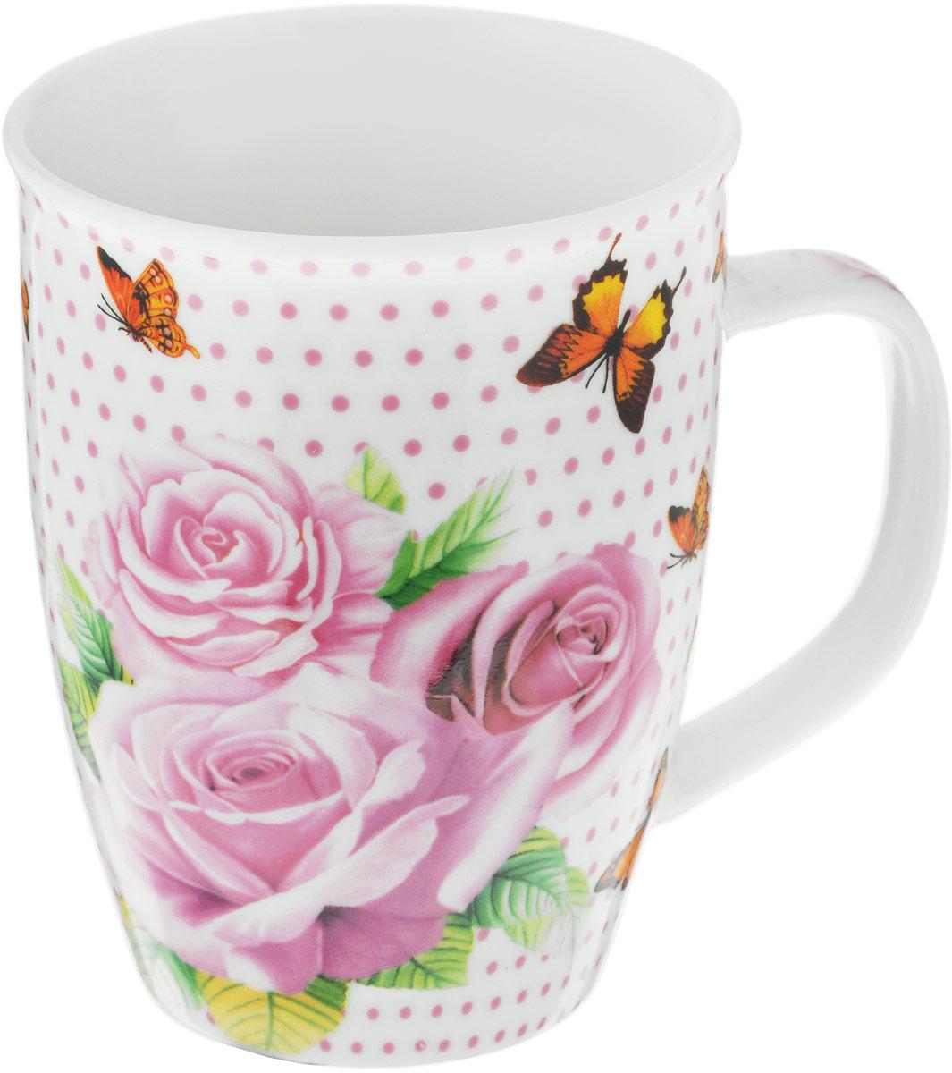 Кружка Loraine Розы и бабочки, 340 мл. 2596925969_розы и бабочкиКружка Loraine Розы с бабочками изготовлена из прочного качественного костяного фарфора. Изделиеоформлено красочным рисунком. Благодаря своим термостатическим свойствам, изделиеотлично сохраняет температуру содержимого - морозной зимой кружка будет согревать васгорячим чаем, а знойным летом, напротив, радовать прохладными напитками.Такой аксессуар создаст атмосферу тепла и уюта, настроит на позитивный лад и подаритхорошее настроение с самого утра. Это оригинальное изделие идеально подойдет в подарокблизкому человеку.Диаметр (по верхнему краю): 8,5 см. Высота кружки: 10,5 см.