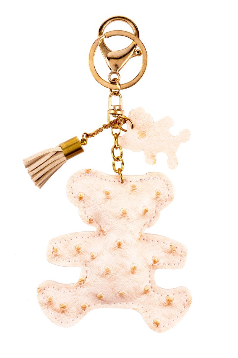 Брелок Медвежонок, цвет: бежевыйМеталлСтильный и практичный аксессуар, который можно использовать в разных целях, послужит достойным украшением вашей сумочки, одежды илиключей. Брелок в виде медвежонка выполнен из искусственной кожи.Крепится брелок при помощи прочного кольца и карабина, гарантирующих сохранность прикрепленных к брелоку ключей и самого брелока.Размер - 8 х 8 см.