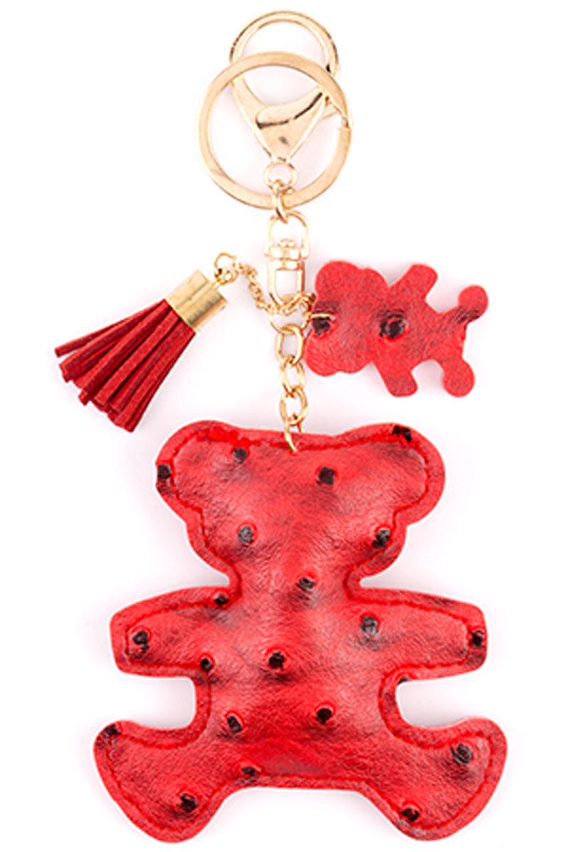 Брелок Медвежонок, цвет: красный32596Стильный и практичный аксессуар, который можно использовать в разных целях, послужит достойным украшением вашей сумочки, одежды или ключей. Брелок в виде медвежонка выполнен из искусственной кожи. Крепится брелок при помощи прочного кольца и карабина, гарантирующих сохранность прикрепленных к брелоку ключей и самого брелока. Размер - 8 х 8 см.