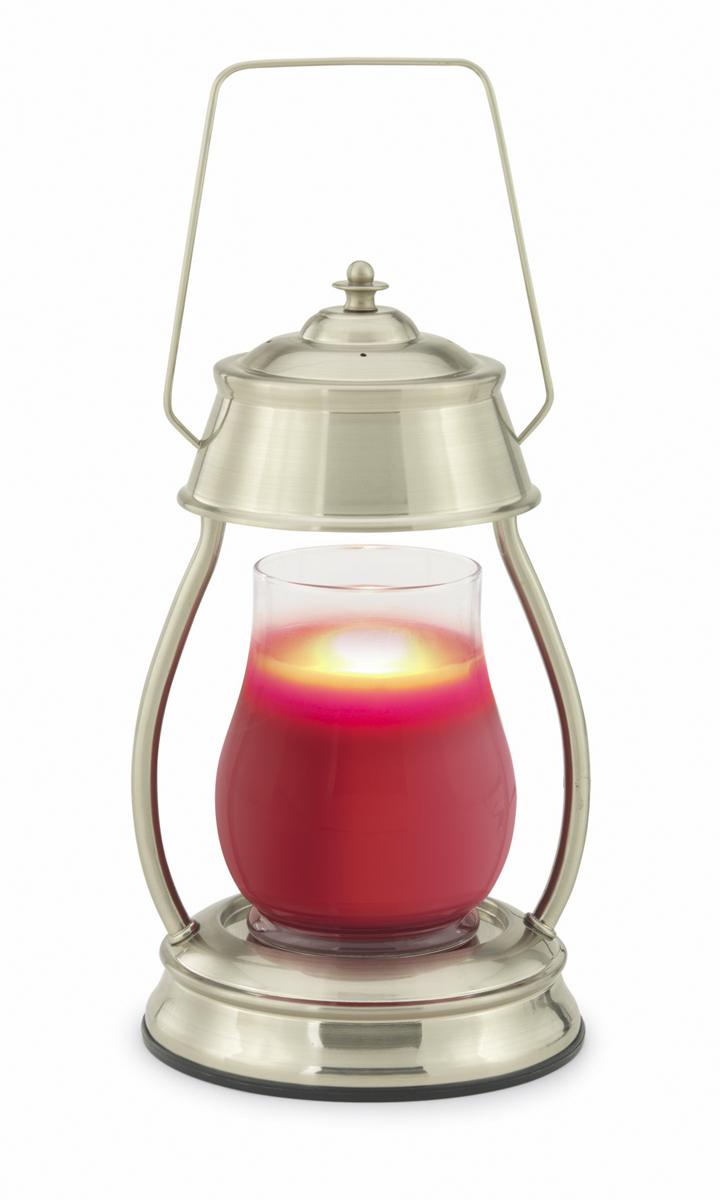 Аромалампа Candle Warmers Hurricane, цвет: серебристыйHLBN-GПредставляем Вашему вниманию лаконичный дизайн и узнаваемый стиль ламп и фонарей от Candle Warmers в современном и классическом стиле.Используйте их для освещения комнаты, декора, а также для ароматизации помещения. Поместите под лампу свечу нужного размера, и наслаждайтесь любимым ароматом без зажигания свечи.Прекрасно подойдёт для безопасного использования без применения огня. Фонарь матовый никель. При ослаблении аромата , жидкий воск можно вылить, и свеча зазвучит по новому. Подойдёт диаметр свечи 10 см, высота 14 см без крышки. Свеча на фото не поставляется в комплекте с лампой.