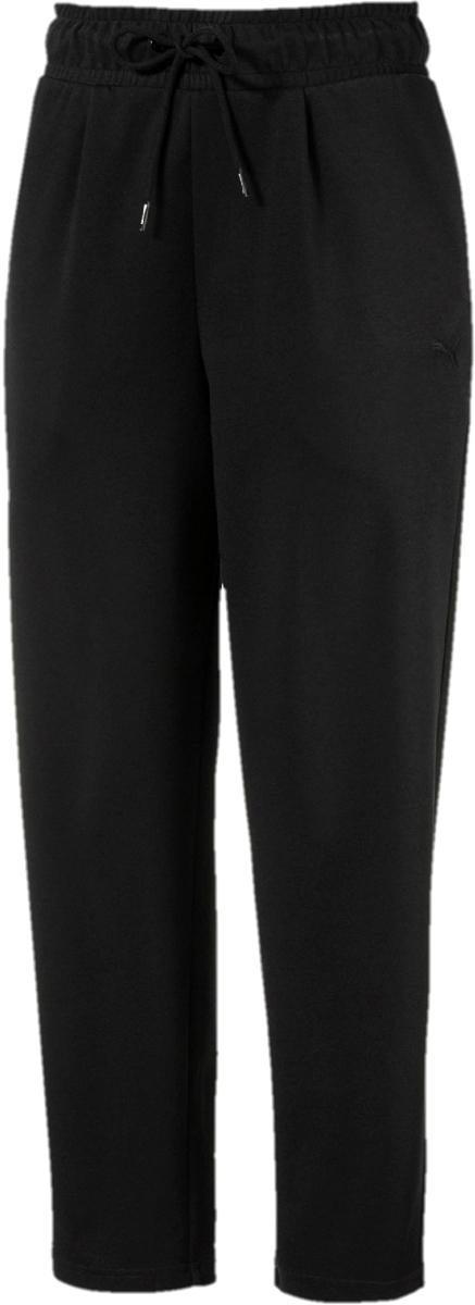 Брюки женские Puma Fusion Pants, цвет: черный. 85011601. Размер L (46/48)85011601Брюки женские Puma изготовлены с использованием высоко функциональной технологии dryCELL, которая отводит влагу и гарантирует комфорт во время активных тренировок и занятий спортом и декорированы вышитым логотипом бренда. Пояс из эластичного материала снабжен затягивающимися шнурами, завязывающимися снаружи, для оптимальной подгонки по фигуре. Карманы в боковых швах удобны и вместительны. Свободный покрой с завышенной талией и немного зауженными внизу штанинами очень элегантен.
