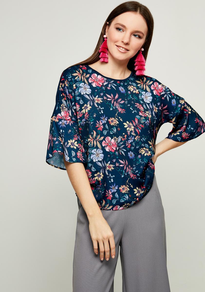 Блузка женская Zarina, цвет: синий. 8123514414056. Размер M (46)8123514414056Блузка Zarina выполнена из высококачественного материала. Модель с круглым вырезом горловины и короткими рукавами, дополнена цветочным принтом.