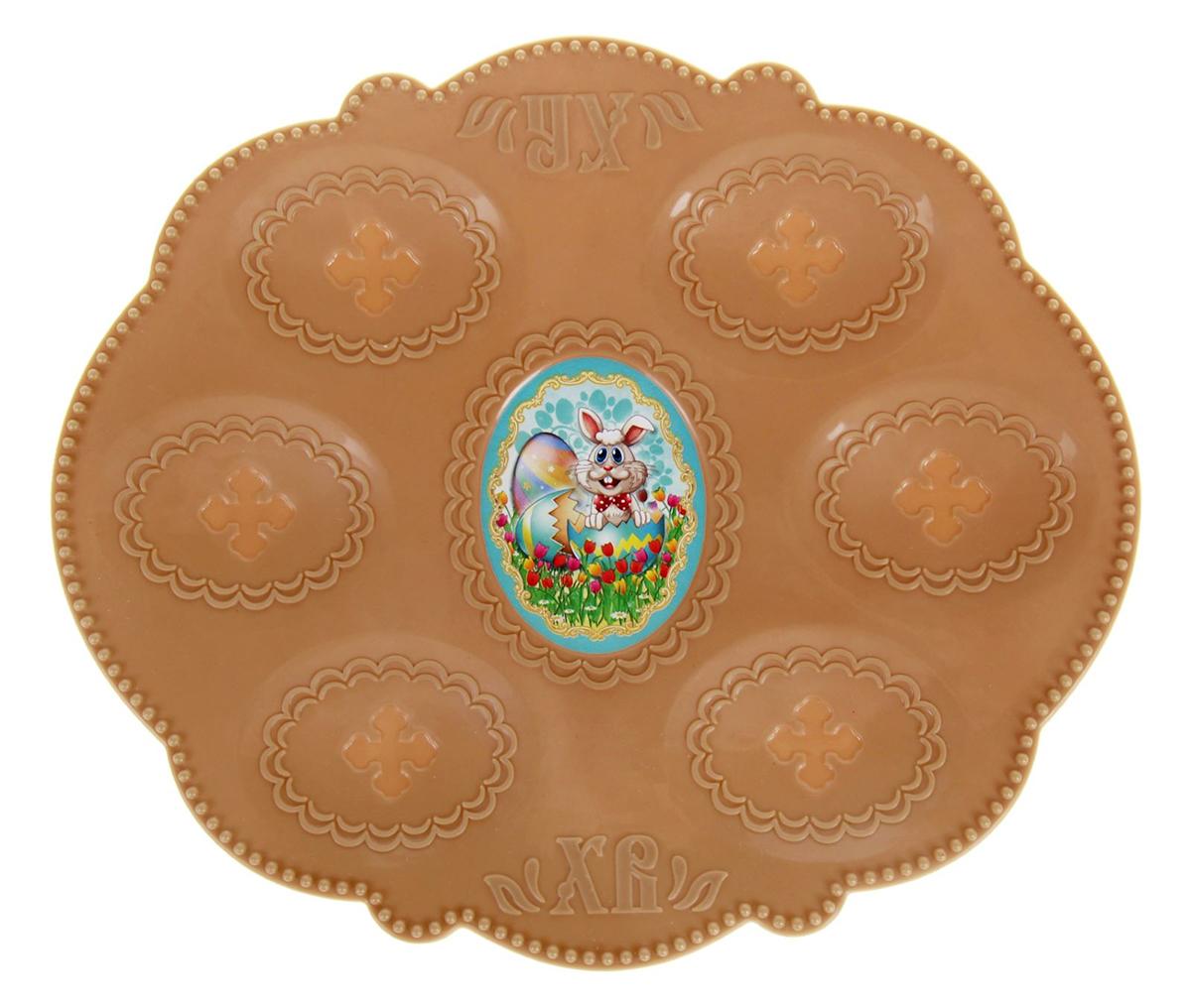 Подставка пасхальная Кролик, для 6 яиц, 21 х 18 см. 10025951002595Пасхальная подставка для 6 яиц изготовлена из качественного пластика, в центре имеется яркая вставка.Аксессуар станет достойным украшением праздничного стола, создаст радостное настроение и наполнит пространство вашего дома благостной энергией на весь год вперёд. Подставка будет ценным памятным подарком для родных, друзей и коллег. Радости, добра и света вам и вашим близким!