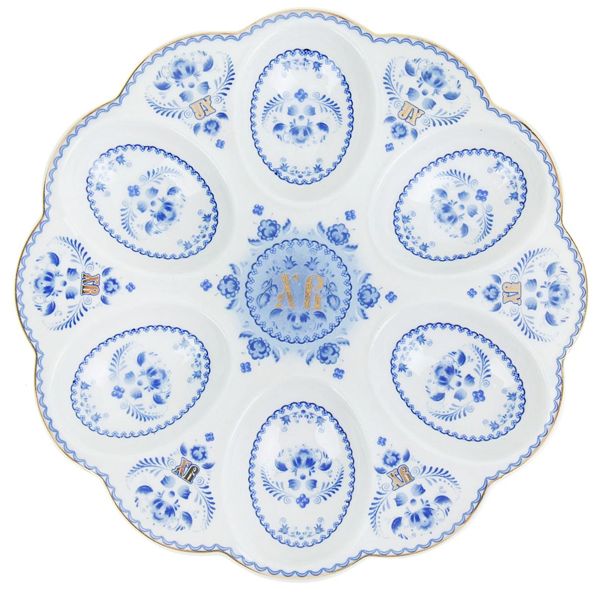 Подставка для яйца Гжель, на 6 яиц, 18 см. 867704867704Подставка изготовлена из прочной белоснежной керамики с нанесением тематических изображений насыщенными натуральными и безопасными красками. Аксессуар станет дополнительным украшением праздничного стола, создаст радостное настроение и наполнит пространство вашего дома благостной энергией на весь год вперёд.Благодаря яркой упаковке сувенир будет ценным памятным подарком для родных, друзей и коллег.