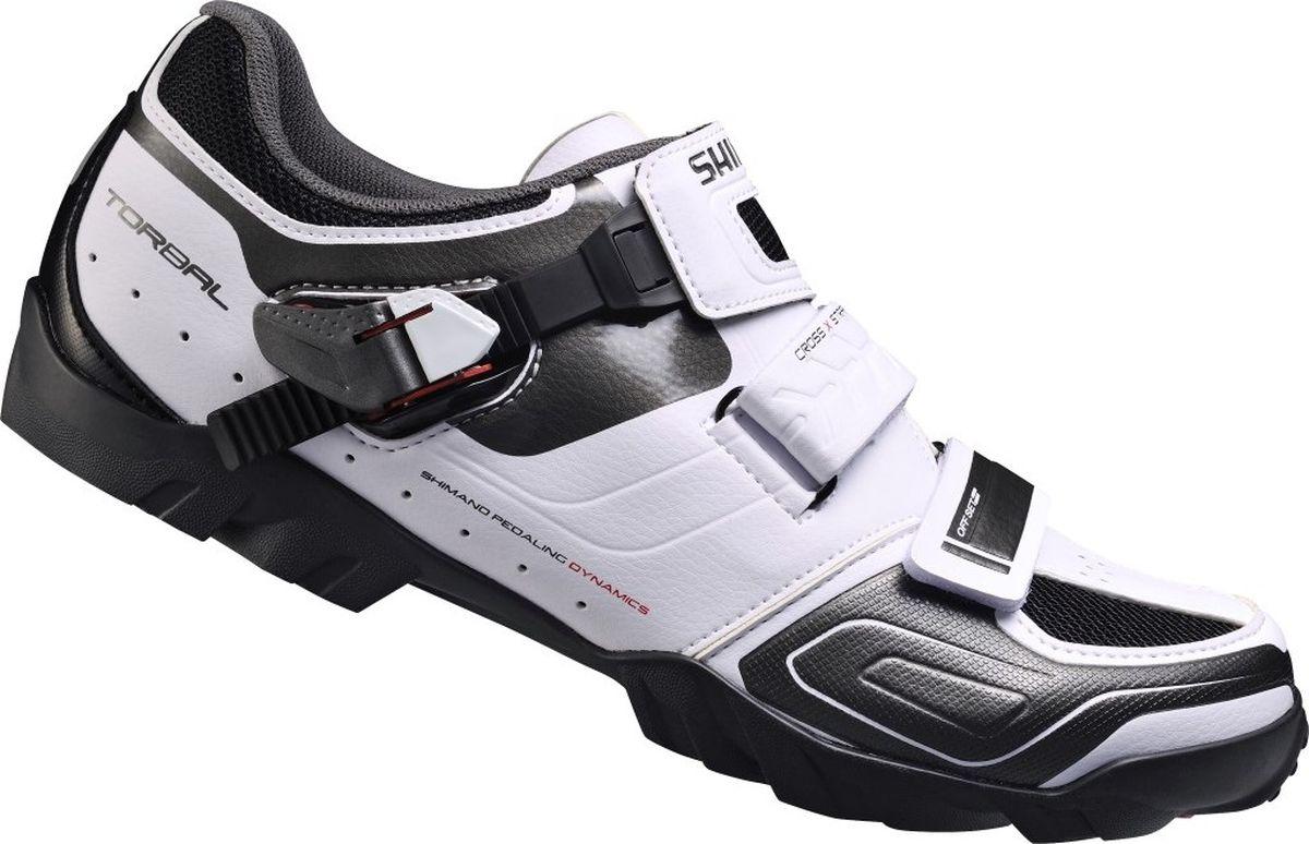 Велотуфли мужские Shimano SH-M089W, цвет: белый. Размер 46SH-M089WТуфли для внедорожних гонок MTB. Универсальность и эффективность на трассе.Верхжесткая устойчивая к растяжению синтетическая кожа и сетка;Cross X-Strap оптимизированы для снижения напряжения верха ступни во время проталкивания педали;сверхнизкопрофильная застежка с микрорегулированием надежно удерживает ногу. Стелькастелька одинарной плотности с повышенной амортизацией принимает форму ноги;противоударная амортизация. Колодкаколодка Volume+ для более удобного носка туфли. ПодошваTorbal Торсионная прослойка подошвы обеспечивает естественное текучее движение велосипедиста во время даунхилла;расширенный диапазон регулировки шипов SPD для удовлетворения потребностей гоночного стиля и трэйла;полиамидная композитная прослойка со стекловолокном для передачи энергии;долговечная резиновая подошва;доступна широкая версия.Индикатор жёсткости: 5.