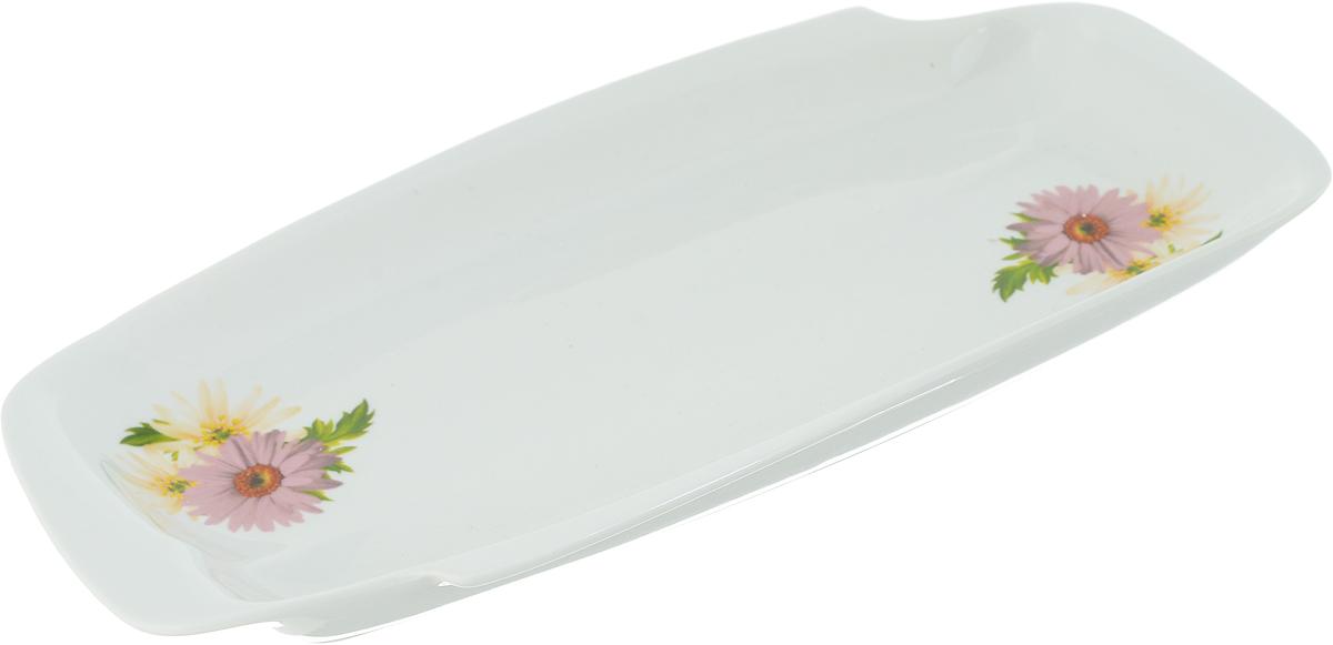Селедочница Фарфор Вербилок Розовые герберы. 1903166019031660Праздничный стол невозможно представить без такой привычной детали, какселедочница. Эта часть праздничного сервиза хорошо известна каждому: продолговатая тарелка, на которой обычно лежит рыбное блюдо или закуска. Но так как в селедочнице можно также увидеть нарезки и другие яства, ее можно считать многофункциональной. Как правило, бортики у этой тарелки низкие, что дает возможность без труда брать кусочки еды специальными лопаточками или вилочками. Украсить свой стол оригинальной селедочницей, значит придать ему особый шарм. Ведь от того, насколько изящно накрыт стол, зависит атмосфера, царящая за ним. Предметы сервировки здесь играют особую роль. И селедочница – один из самых необходимых элементов для полноценного праздничного стола.