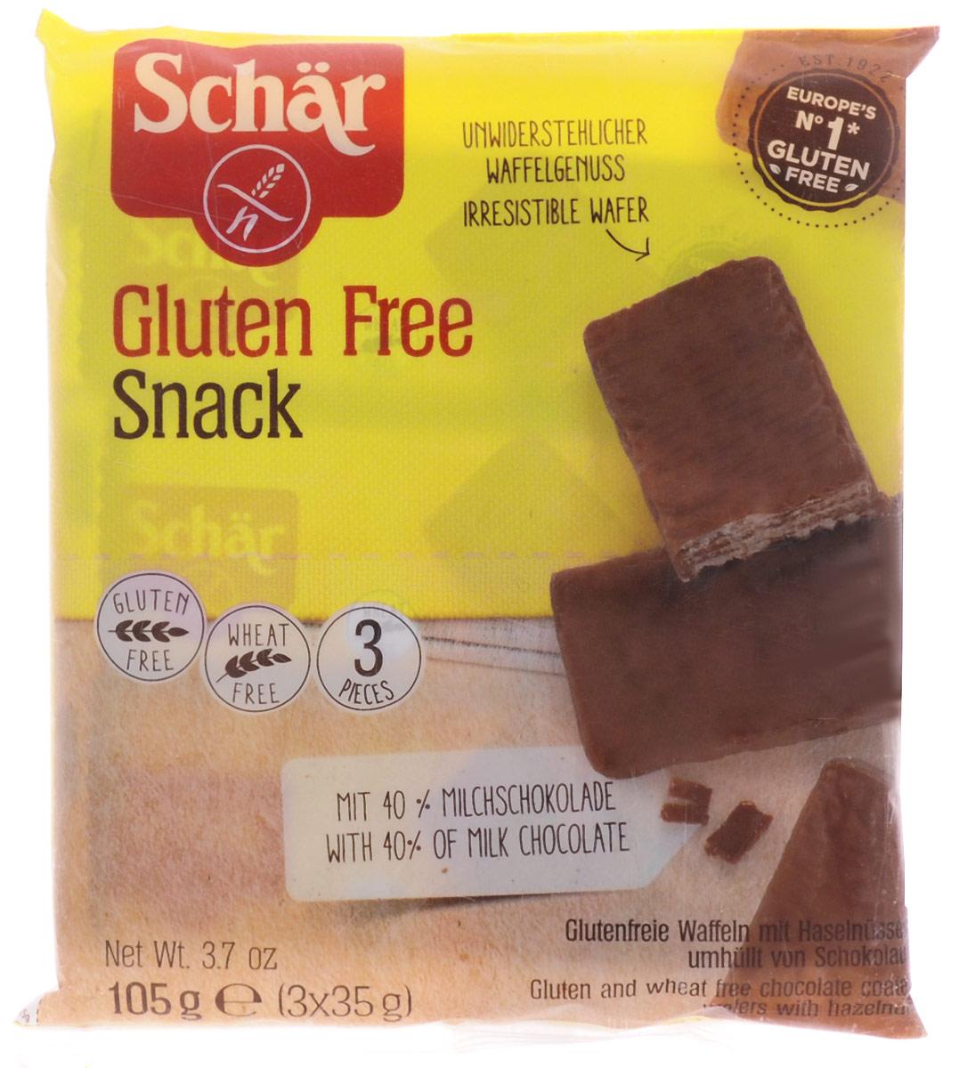 """Dr. Schar Snack Вафли в шоколаде с орехами, 3 шт по 35 г8008698005286Вафли Snack от Dr. Schar - хрустящие вафли с начинкой из орехового крема, покрытые шоколадом - отличный заряд энергии! Рекомендуются для профилактики и лечения пищевой аллергии, больных целиакией (непереносимость растительного белка) и людей, соблюдающих безглютеновую диету. Продукт произведен из экологически чистого сырья, с соблюдением строгих технологических требований и экологических стандартов Европейского союза, отмечен международным значком """"Gluten free""""."""