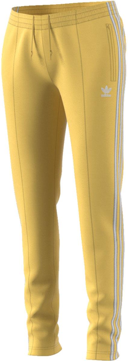 Брюки женские Adidas Sst Tp, цвет: желтый. CE2405. Размер 34 (42)CE2405Современная модель со спортивным прошлым. Женские брюки с хорошо узнаваемыми аутентичными деталями в стиле модели SST. Гладкий трикотаж, облегающий крой и декоративные стрелки на лицевой стороне. Три полоски завершают винтажный образ.Боковые прорезные карманыЭластичный пояс на регулируемых завязках-шнуркахДекоративные стрелки спередиТрилистник на ногеКонтрастные три полоски по бокам