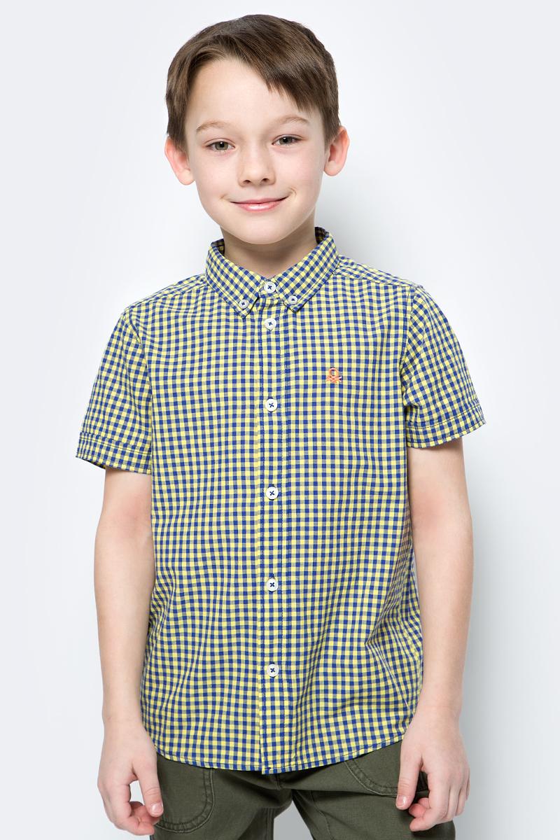 Рубашка для мальчика United Colors of Benetton, цвет: желтый, синий. 5FU95QBG0_945. Размер 1405FU95QBG0_945Рубашка от United Colors of Benetton выполнена из натурального хлопкового материала. Модель с короткими рукавами и отложным воротником застегивается на пуговицы.