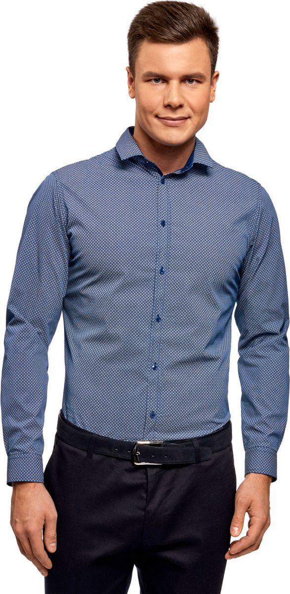 Рубашка мужская oodji Lab, цвет: синий, темно-синий. 3L110306M/19370N/7579G. Размер 40 (48-182)3L110306M/19370N/7579GЭлегантная рубашка с длинными рукавами и аккуратным отложным воротником. Модель приталенного силуэта с застежкой на пуговицы, рукавами с манжетами и округлым низом смотрится стильно и одновременно сдержанно. Ткань из хлопка приятна для тела, дышит и хорошо отводит влагу, не раздражая кожу. В такой рубашке вам будет комфортно целый день. Приталенный крой подчеркивает силуэт и подходит для разных фигур. Приталенная хлопковая рубашка органично впишется в ваш базовый гардероб. Она универсальна и будет уместна в любой ситуации. Ее можно надеть, собираясь на работу или официальное мероприятие. Прекрасный комплект получится с классическими брюками и туфлями или оксфордами. Эта же рубашка подойдет и для отдыха, встречи с друзьями в приятной обстановке. Достаточно лишь дополнить ее джинсами и ботинками в стиле casual. В этой рубашке вы всегда будете выглядеть непринужденно и элегантно.