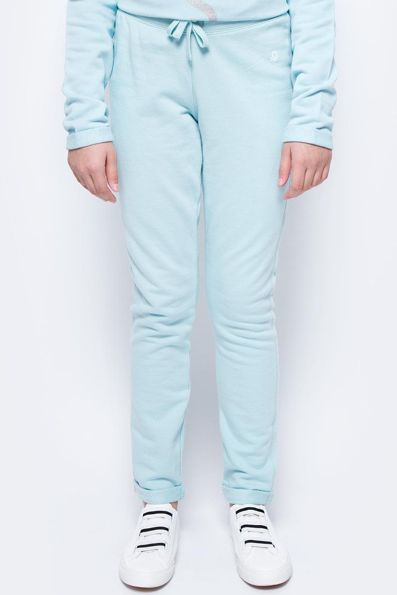 Брюки для девочки United Colors of Benetton, цвет: бирюзовый. 3J68I0122_0N5. Размер 1203J68I0122_0N5Трикотажные брюки от United Colors of Benetton выполнены из натурального хлопка. Модель прямого кроя с эластичной резинкой на талии дополнена регулируемым шнурком.