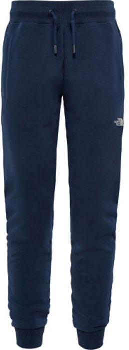 Брюки спортивные женские The North Face W Slim Pant, цвет: синий. T93BP2H2G. Размер L (48)T93BP2H2GМягкие, комфортные брюки от The North Face для легких походов в прохладную погоду. Брюки сделаны из чистого хлопка, что создает приятное ощущение для кожи. Вышитое спереди и сзади лого The North Face добавляет горного стиля модели.